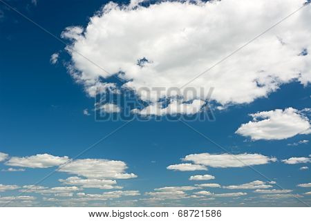 Clouds On A Bright Blue Sky.