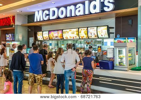 People buying fast-food from McDonald's Restaurant