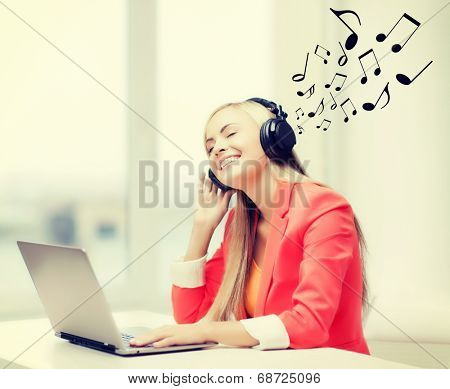 leisure, music, free time, online and internet concept - happy woman with headphones listening to music