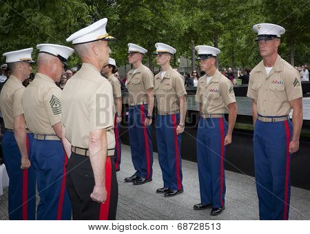 NEW YORK - MAY 23, 2014: U.S. Marines stand at attention during the re-enlistment and promotion ceremony at the National September 11 Memorial site.