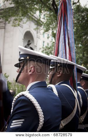 NEW YORK - MAY 23: Members of the US Coast Guard Silent Drill Team perform in Herald Square in front of the Macys store during Fleet Week NY on May 23, 2014.