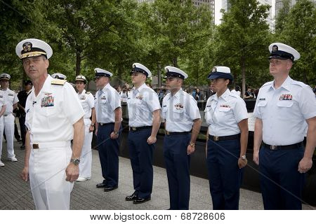 NEW YORK - MAY 23, 2014: Rear Admiral Scott A. Stearney stands in front of Coast Guardsmen participating in the re-enlistment and promotion ceremony at the National September 11 Memorial site.