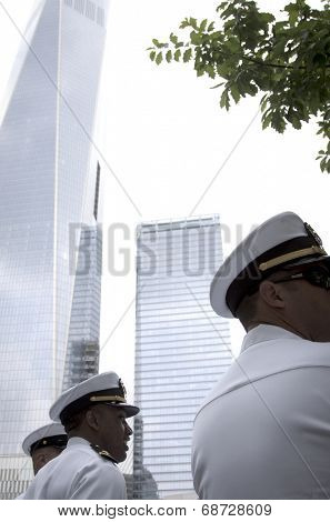 NEW YORK - MAY 23, 2014: Low angle view of US Navy officers with the Freedom Tower in the background during the re-enlistment and promotion ceremony at the National September 11 Memorial site.