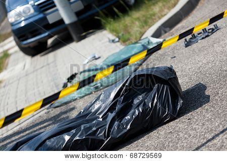 Car Accident And Corpse In Bag