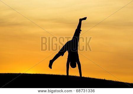 Cartwheel At Sunset.