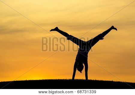 Middle Of A Cartwheel At Sunset.