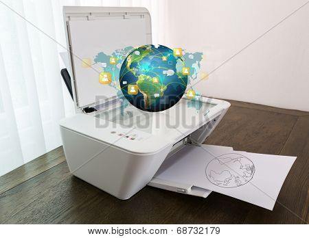 Printer with earth of social network on paper (Elements of this image furnished by NASA)