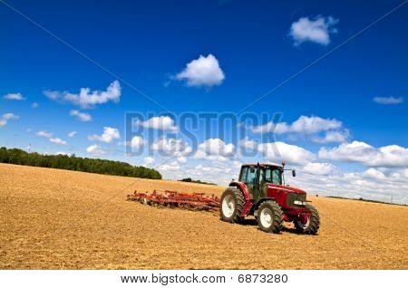 Tractor In Plowed Field