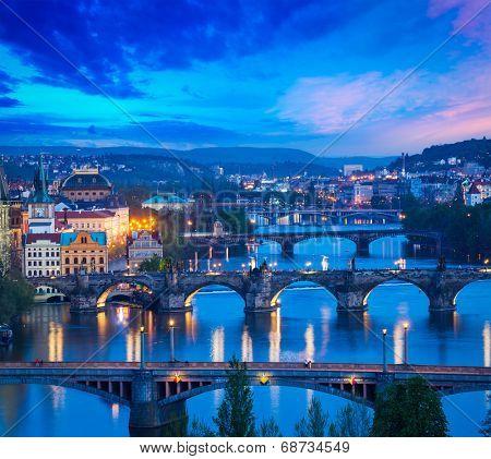 Travel Prague concept background - elevated view of bridges over Vltava river from Letn���¡ Park. Prague, Czech Republic in twilight