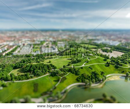 Aerial view of Olympiapark and Munich from Olympiaturm (Olympic Tower) with tilt shift toy effect shallow depth of field. Munich, Bavaria, Germany