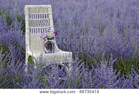 mason jar with bouquet on chair