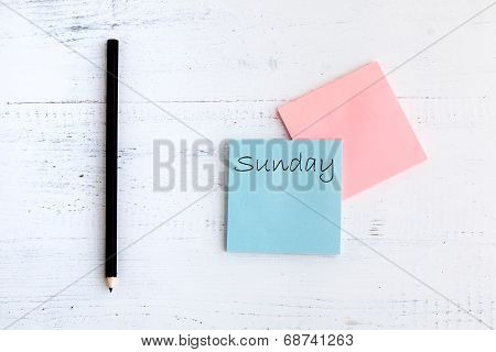 Notebook With Pencil And Word Sunday