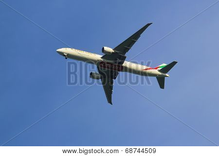 Emirates Airline Boeing 777 in New York sky before landing at JFK Airport