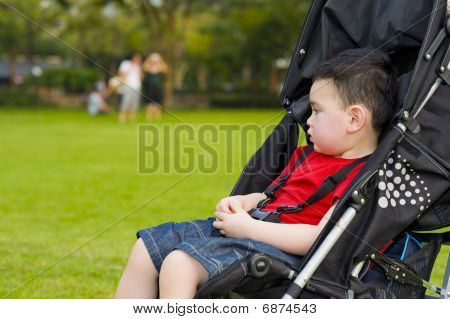 Boy In Baby Buggy