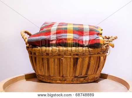 Colorful Loincloth Fabric On Rattan Basket