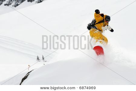 Yellow snowboarder jumping