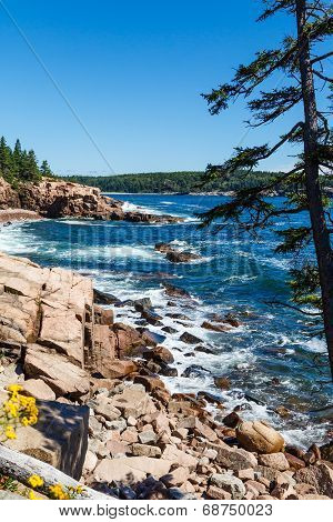 Blue Water And White Surf On Rocky Coast