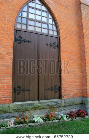 Arched doorway of stone and brick building