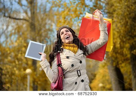 Happy Woman Shopping And Holding Digital Tablet