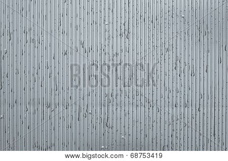 Water Drops On A Corrugated Plate Of Silver Color