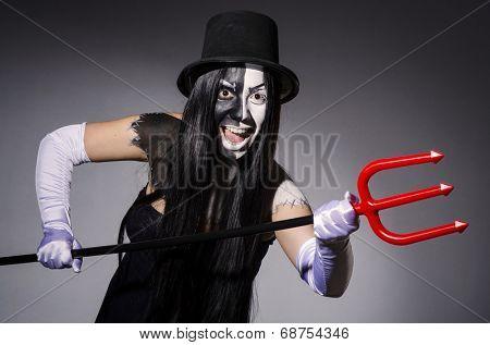 Satana woman with pitchfork and facemask