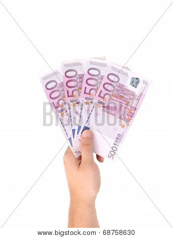 Man hands holding five hundred euro banknotes.
