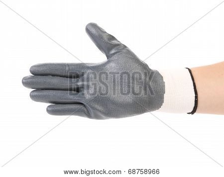 Hand in black rubber glove.