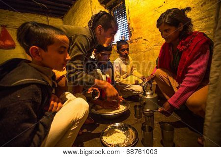KATHMANDU, NEPAL - DEC 9, 2013: Unknown children during dinner at Jagadguru School. School established at 2013, to let new generation learn Sanskrit and preserve Hindu culture.