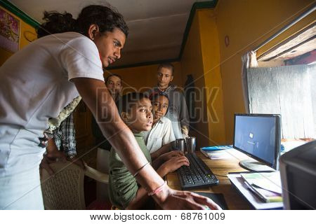 KATHMANDU, NEPAL - DEC 9, 2013: Unknown children in lesson on the computer at Jagadguru School. School established at 2013, to let new generation learn Sanskrit and preserve Hindu culture.