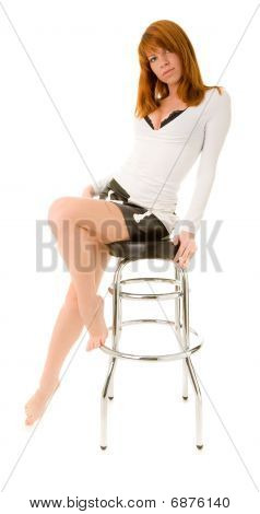 Red Haired Girl On A Bar Chair