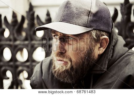 Portrait of homeless man in despair