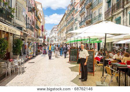 Lisbon, Portugal - MAY 26: Unidentified tourists are walking at Santo Antao street  on May 26, 2014 at Lisbon ,Portugal. Santo Antao is a lively pedestrian street known for its seafood restaurants.