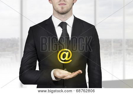 Businessman Holding Web At Symbol In Hand