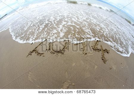 Wave That Erases 2014 Year Written On The Sea Beach 3