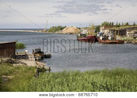 View of a traditional fishing village with boats moored