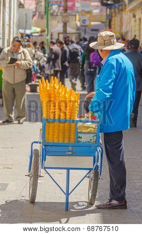 LA PAZ, BOLIVIA, MAY 8, 2014 - Street seller of ice cream sells his merchandise on busy Comercio street