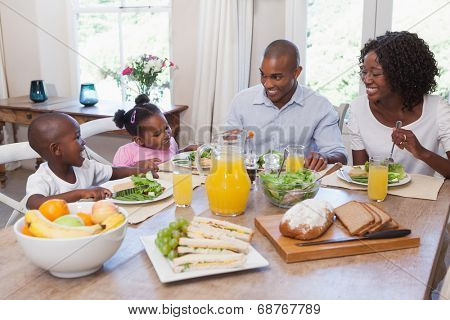 Happy family having lunch together at home in the kitchen
