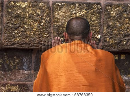 Buddhist Monk Prays At The Dhamekh Stupa.