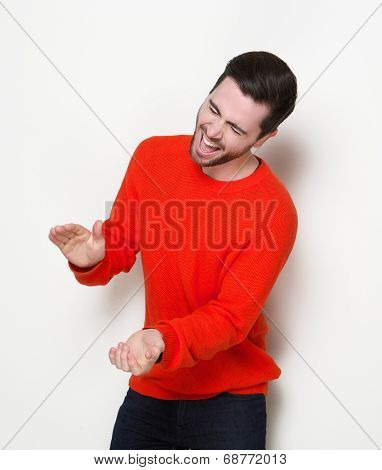 Young Man Laughing And Clapping Hands