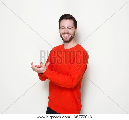 Young Man Smiling And Clapping Hands