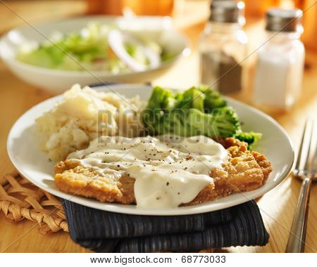 country fried steak with southern style peppered milk gravy