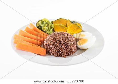 Vegetarian Food, Contains Coarse Rice, Egg, Carrot, Pumpkin And Broccoli Isolated On White Backgroun