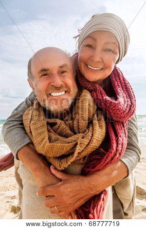 hug two beloved older people enjoying time
