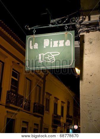 Pizzeria Signboard In A European Street.