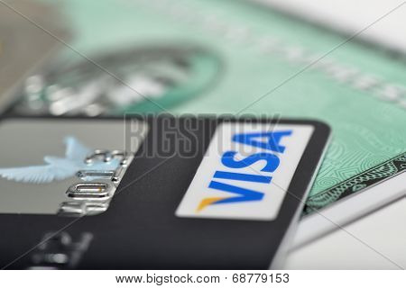 Ankara, Turkey - October 17, 2012 : Studio shot of two major credit cards Visa and American express over white background