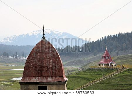 Mosque and Hindu temple in mountains of Kashmir