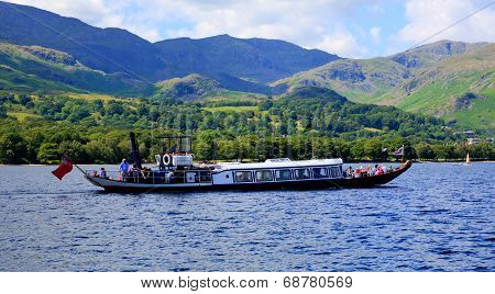 Holidaymakers on a Gondola steam boat on Coniston water Lake District England uk on a summer day