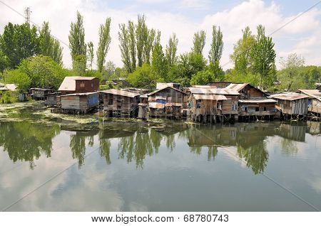 Slum houses near the river, Srinagar, India