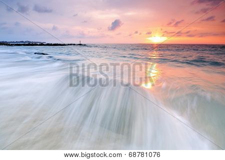 Long exposure of waves at sunset