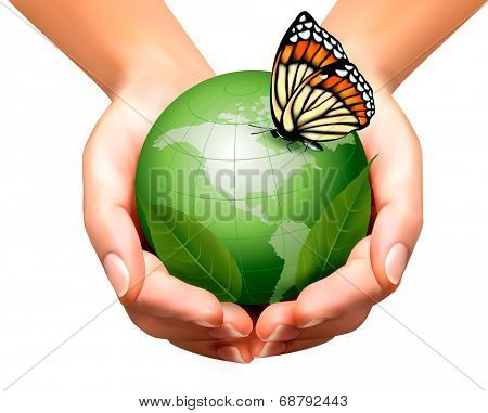 Green world with leaf and butterfly in woman hands.